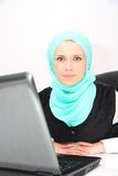 Beautiful young muslim business woman with laptop in office Stock Image