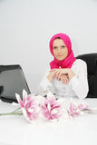 Beautiful young muslim business woman with laptop in office Stock Photography