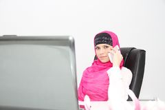 Beautiful young muslim business woman with laptop in office Royalty Free Stock Image