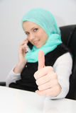 Beautiful young muslim business woman with laptop in office Royalty Free Stock Photo