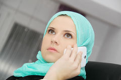 Beautiful young muslim business woman with laptop in office Stock Photos