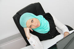 Beautiful young muslim business woman with laptop in office Royalty Free Stock Photography
