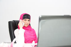 Beautiful young muslim business woman with laptop in office Royalty Free Stock Images