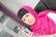 Beautiful young muslim business woman with laptop in office Stock Images
