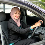 Beautiful young muslim businesswomen smile inside car Stock Photography