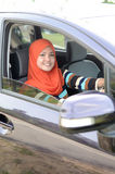 Beautiful young muslim drive car Royalty Free Stock Photo