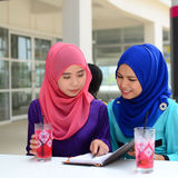 Beautiful young muslim student sharing info together Stock Photography