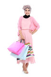 Beautiful young muslim woman holding a few shopping bags Royalty Free Stock Images