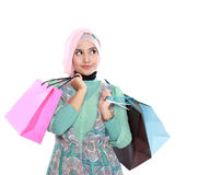 Beautiful young muslim woman holding a few shopping bags Royalty Free Stock Photo