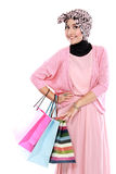 Beautiful young muslim woman holding a few shopping bags Stock Image