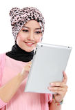 Beautiful young muslim woman using digital tablet computer Stock Photography