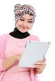 Beautiful young muslim woman using tablet computer Royalty Free Stock Photos