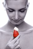Beautiful young naked girl with red juicy strawberry in her hand Royalty Free Stock Photo