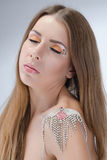 Beautiful young naked woman with bright makeup wearing necklace. Fashion shoot Royalty Free Stock Photography
