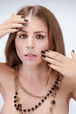 Beautiful young naked woman with bright makeup wearing necklace. Fashion shoot Royalty Free Stock Image