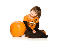Beautiful young next to Pumpkin stock images