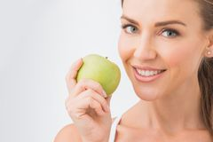Perfect woman with apple Royalty Free Stock Photos