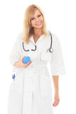 Beautiful young nurse is flirting with blue enema Royalty Free Stock Image