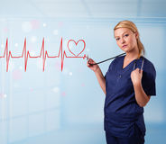 Young nurse listening to abstract pulse with red heart Royalty Free Stock Photo