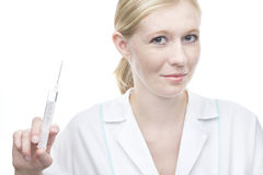 Beautiful young nurse with syringe Royalty Free Stock Photography