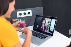 Beautiful Young Nutritionist Woman Having An Online Video Call Via Laptop Computer With A Friend In The Kitchen At Home Stock Photos