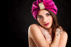Beautiful young oriental woman in turban Stock Image