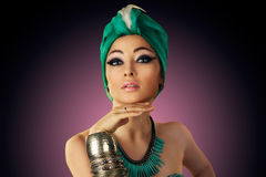 Beautiful young oriental woman in turban Stock Photography