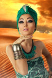 Beautiful young oriental woman in turban Stock Images