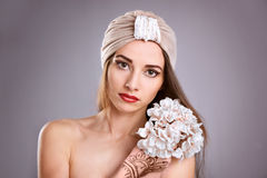 Beautiful young oriental woman in turban. Beautiful young oriental woman Royalty Free Stock Images