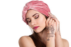Beautiful young oriental woman in turban Royalty Free Stock Photos