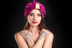 Beautiful young oriental woman in turban. Beautiful young oriental woman Stock Photo