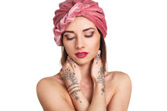 Beautiful young oriental woman in turban Royalty Free Stock Photography