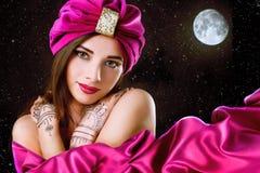 Beautiful young oriental woman in turban Stock Photo