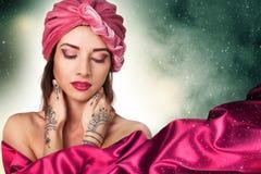 Beautiful young oriental woman in turban Royalty Free Stock Photo
