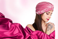 Beautiful young oriental woman in turban Royalty Free Stock Image