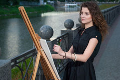 Beautiful young painter draws a picture Royalty Free Stock Photos