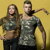 Beautiful young pair in camouflage Stock Photo
