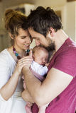 Beautiful young parents holding their cute baby daughter Royalty Free Stock Photo