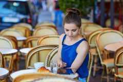 Beautiful young Parisian woman in cafe Royalty Free Stock Photo