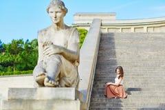 Beautiful young Parisian woman in long brown silk skirt Stock Photography