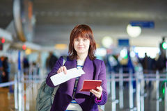 Beautiful young passenger at check-in counter Stock Images