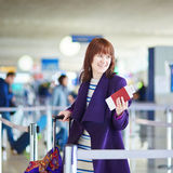 Beautiful young passenger at check-in counter Royalty Free Stock Photography