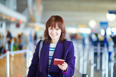 Beautiful young passenger at check-in counter Royalty Free Stock Image