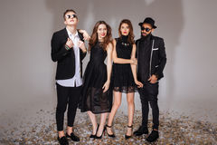Beautiful young people in black suits and dresses Royalty Free Stock Image
