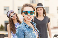 Beautiful young people on city background Stock Images