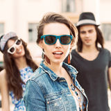 Beautiful young people on city background Stock Photo