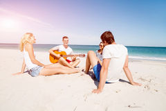 Beautiful young people with guitar on beach Royalty Free Stock Image