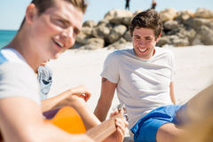 Beautiful young people with guitar on beach Stock Images