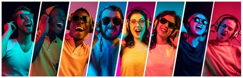 Beautiful young people in neon light isolated on multicolored studio background stock photos