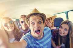 Beautiful young people a on road trip Royalty Free Stock Image